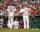 Aug 27, 2013; Washington, DC, USA; Washington Nationals third baseman Ryan Zimmerman (11) is congratulated by first baseman Adam LaRoche (25) after scoring a run during the first inning against the Miami Marlins at Nationals Park. Mandatory Credit: Brad Mills-USA TODAY Sports