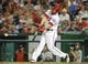 Aug 27, 2013; Washington, DC, USA; Washington Nationals left fielder Bryce Harper (34) hits a single during the fifth inning against the Miami Marlins at Nationals Park. Mandatory Credit: Brad Mills-USA TODAY Sports