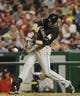 Aug 27, 2013; Washington, DC, USA; Miami Marlins left fielder Christian Yelich (21) hits a solo home run during the sixth inning against the Washington Nationals at Nationals Park. Mandatory Credit: Brad Mills-USA TODAY Sports