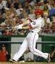 Aug 27, 2013; Washington, DC, USA; Washington Nationals first baseman Adam LaRoche (25) hits a single during the sixth inning at Nationals Park. Mandatory Credit: Brad Mills-USA TODAY Sports