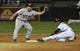 Aug 27, 2013; Chicago, IL, USA; Chicago White Sox shortstop Alexei Ramirez (10) steals second base as Houston Astros second baseman Jose Altuve (27) takes the throw during the fourth inning at U.S. Cellular Field. Mandatory Credit: David Banks-USA TODAY Sports