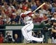 Aug 27, 2013; Washington, DC, USA; Washington Nationals shortstop Ian Desmond (20) singles during the eighth inning against the Miami Marlins at Nationals Park. Mandatory Credit: Brad Mills-USA TODAY Sports