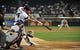 Aug 28, 2013; Chicago, IL, USA; Chicago White Sox first baseman Paul Konerko (14) hits an RBI single against the Houston Astros during the first inning at U.S. Cellular Field.  Mandatory Credit: David Banks-USA TODAY Sports