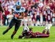 Aug 29, 2013; Columbia, SC, USA; North Carolina Tar Heels tight end Jack Tabb (80) makes a reception as South Carolina Gamecocks linebacker Sharrod Golightly (9) attempts the tackle in the second quarter at Williams-Brice Stadium. Mandatory Credit: Jeff Blake-USA TODAY Sports