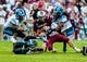 Aug 29, 2013; Columbia, SC, USA; South Carolina Gamecocks quarterback Connor Shaw (14) is brought down after scrambling by North Carolina Tar Heels cornerback Tim Scott (7) and safety Tre Boston (10) in the second quarter at Williams-Brice Stadium. Mandatory Credit: Jeff Blake-USA TODAY Sports