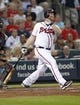 Aug 29, 2013; Atlanta, GA, USA; Atlanta Braves catcher Brian McCann (16) hits a home run against the Cleveland Indians in the third inning at Turner Field. Mandatory Credit: Brett Davis-USA TODAY Sports