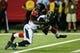 Aug 29, 2013; Atlanta, GA, USA; Jacksonville Jaguars running back Jordan Todman (30) scores a touchdown as Atlanta Falcons cornerback Desmond Trufant (21) attempts to make the tackle in the first quarter at the Georgia Dome. Mandatory Credit: Daniel Shirey-USA TODAY Sports