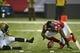 Aug 29, 2013; Atlanta, GA, USA; Atlanta Falcons defensive end Jonathan Massaquoi (96) returns a fumble by Jacksonville Jaguars quarterback Matt Scott (5) for a touchdown during the second quarter at the Georgia Dome. Mandatory Credit: Dale Zanine-USA TODAY Sports