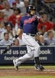 Aug 29, 2013; Atlanta, GA, USA; Cleveland Indians first baseman Carlos Santana (41) hits a single against the Atlanta Braves in the seventh inning at Turner Field. Mandatory Credit: Brett Davis-USA TODAY Sports