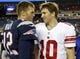 Aug 29, 2013; Foxborough, MA, USA; New England Patriots quarterback Tom Brady (12) and New York Giants quarterback Eli Manning (10) meet on the field after the game Gillette Stadium. The Patriots defeated the Giants 28-20. Mandatory Credit: David Butler II-USA TODAY Sports