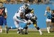 Aug 29, 2013; Charlotte, NC, USA; Carolina Panthers wide receiver James Shaw (10) is pushed towards the goal line by tight end Brandon Williams (86) while defended by Pittsburgh Steelers Isaiah Green (39) during the game at Bank Of America Stadium. Panthers win 25-10. Mandatory Credit: Sam Sharpe-USA TODAY Sports