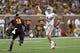 Aug 29, 2013; Minneapolis, MN, USA; UNLV Rebels quarterback Nick Sherry (3) throws the ball over Minnesota Golden Gophers linebacker James Manuel (9) in the third quarter at TCF Bank Stadium. The Gophers won 51-23. Mandatory Credit: Jesse Johnson-USA TODAY Sports