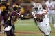 Aug 29, 2013; Minneapolis, MN, USA; UNLV Rebels running back Shaquille Murray-Lawrence (33) stuff arms Minnesota Golden Gophers defensive back Marcus Jones (15) in the third quarter at TCF Bank Stadium. The Gophers won 51-23. Mandatory Credit: Jesse Johnson-USA TODAY Sports
