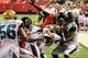 Aug 29, 2013; Atlanta, GA, USA; Atlanta Falcons quarterback Dominique Davis (4) is tackled by Jacksonville Jaguars linebacker Brandon Marshall (52) in the second half at the Georgia Dome. The Jaguars won 20-16. Mandatory Credit: Daniel Shirey-USA TODAY Sports