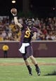 Aug 29, 2013; Minneapolis, MN, USA; Minnesota Golden Gophers quarterback Philip Nelson (9) throws a pass in the third quarter against the UNLV Rebels at TCF Bank Stadium. The Gophers won 51-23. Mandatory Credit: Jesse Johnson-USA TODAY Sports