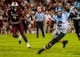 Aug 29, 2013; Columbia, SC, USA; North Carolina Tar Heels quarterback Bryn Renner (2) scrambles for yardage as South Carolina Gamecocks defensive end Jadeveon Clowney (7) pursues in the fourth quarter at Williams-Brice Stadium. Mandatory Credit: Jeff Blake-USA TODAY Sports