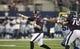 Aug 29, 2013; Arlington, TX, USA; Houston Texans quarterback T.J. Yates (13) throws a pass during the fourth quarter of the game against the Dallas Cowboys at AT&T Stadium. Houston beat Dallas 24-6. Mandatory Credit: Tim Heitman-USA TODAY Sports