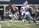 Aug 29, 2013; Arlington, TX, USA; Houston Texans wide receiver Andy Cruse (12) runs for a touchdown while chased by Dallas Cowboys linebacker Caleb McSurdy (56) at AT&T Stadium. Houston beat Dallas 24-6. Mandatory Credit: Tim Heitman-USA TODAY Sports