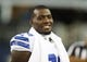 Aug 29, 2013; Arlington, TX, USA; Dallas Cowboys wide receiver Dez Bryant (88) smiles while on the sideline during the game against the Houston Texans at AT&T Stadium. Houston beat Dallas 24-6. Mandatory Credit: Tim Heitman-USA TODAY Sports