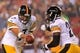 Aug 19, 2013; Landover, MD, USA; Pittsburgh Steelers quarterback Ben Roethlisberger (7) hands the ball off to Steelers running back Le'Veon Bell (26) against the Washington Redskins at FedEx Field. Mandatory Credit: Geoff Burke-USA TODAY Sports