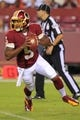 Aug 19, 2013; Landover, MD, USA; Washington Redskins quarterback Pat White (5) runs with the ball against the Pittsburgh Steelers at FedEx Field. Mandatory Credit: Geoff Burke-USA TODAY Sports