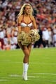 Aug 19, 2013; Landover, MD, USA; A Washington Redskins cheerleader dances on the field against the Pittsburgh Steelers at FedEx Field. Mandatory Credit: Geoff Burke-USA TODAY Sports