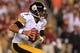 Aug 19, 2013; Landover, MD, USA; Pittsburgh Steelers quarterback Bruce Gradkowski (5) runs with the ball against the Washington Redskins at FedEx Field. Mandatory Credit: Geoff Burke-USA TODAY Sports