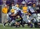 Aug 30, 2013; Manhattan, KS, USA; North Dakota State Bison quarterback Brock Jensen (16) is tackled by Kansas State Wildcats defensive back Ty Zimmerman (12) and defensive lineman Chaquil Reed (98) during first-half action at Bill Snyder Family Stadium. Mandatory Credit: Scott Sewell-USA TODAY Sports