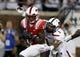 Aug 30, 2013; Dallas, TX, USA; Southern Methodist Mustangs wide receiver Jeremy Johnson (15) catches a pass against Texas Tech Red Raiders linebacker Terrance Bullitt (1) in the second quarter of the game at Gerald J. Ford Stadium. Mandatory Credit: Tim Heitman-USA TODAY Sports