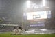 Aug 30, 2013; Detroit, MI, USA; Grounds crew pull the tarp onto the field during the seventh inning after the game between the Detroit Tigers and the Cleveland Indians at Comerica Park. Mandatory Credit: Rick Osentoski-USA TODAY Sports