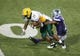 Aug 30, 2013; Manhattan, KS, USA; North Dakota State Bison running back John Crockett (23) is tackled by Kansas State Wildcats defensive back Kip Daily (7) during the Bisons' 24-21win at Bill Snyder Family Stadium. Mandatory Credit: Scott Sewell-USA TODAY Sports