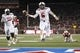 Aug 30, 2013; Dallas, TX, USA; Texas Tech Red Raiders quarterback Baker Mayfield (6) scores a touchdown in the fourth quarter of the game against the Southern Methodist Mustangs at Gerald J. Ford Stadium. Texas Tech won 41-23. Mandatory Credit: Tim Heitman-USA TODAY Sports