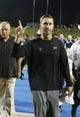 Aug 30, 2013; Dallas, TX, USA; Texas Tech Red Raiders head coach Kliff Kingsbury motions to the crowd while Southern Methodist Mustangs head coach June Jones walks behind after the game at Gerald J. Ford Stadium. Texas Tech won 41-23. Mandatory Credit: Tim Heitman-USA TODAY Sports