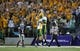 Aug 30, 2013; Manhattan, KS, USA; North Dakota State Bison quarterback Brock Jensen (16), right, celebrates a touchdown with punter Ben LeCompte (19) during a 24-21 win against the Kansas State Wildcats at Bill Snyder Family Stadium. Mandatory Credit: Scott Sewell-USA TODAY Sports