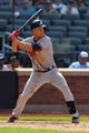 Aug 21, 2013; New York, NY, USA; Atlanta Braves shortstop Andrelton Simmons (19) bats against the New York Mets at Citi Field. Mandatory Credit: Brad Penner-USA TODAY Sports