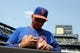 Aug 21, 2013; New York, NY, USA; New York Mets manager Terry Collins (10) signs autographs before a game against the Atlanta Braves at Citi Field. Mandatory Credit: Brad Penner-USA TODAY Sports