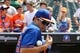 Aug 21, 2013; New York, NY, USA; New York Mets catcher Travis d'Arnaud (15) signs autographs before a game against the Atlanta Braves at Citi Field. Mandatory Credit: Brad Penner-USA TODAY Sports