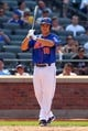 Aug 21, 2013; New York, NY, USA; New York Mets catcher Travis d'Arnaud (15) bats against the Atlanta Braves at Citi Field. Mandatory Credit: Brad Penner-USA TODAY Sports