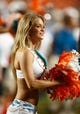 Aug 24, 2013; Miami Gardens, FL, USA;  A Miami Dolphins cheerleader performs in the second half of a game against the Tampa Bay Buccaneers at Sun Life Stadium.  Mandatory Credit: Robert Mayer-USA TODAY Sports