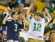Aug 23, 2013; Green Bay, WI, USA; Seattle Seahawks and Green Bay Packers fans cheer during the game at Lambeau Field.  Seattle won 17-10.  Mandatory Credit: Jeff Hanisch-USA TODAY Sports