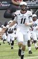 Aug 31, 2013; Cincinnati, OH, USA; Cincinnati Bearcats quarterback Brendon Kay (11) runs onto the field at the beginning of their game with the Purdue Boilermakers at Nippert Stadium. Mandatory Credit: David Kohl-USA TODAY Sports