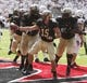 Aug 31, 2013; Cincinnati, OH, USA; Purdue Boilermakers quarterback Rob Henry (15) celebrates in the end zone after scoring a second quarter touchdown against the Cincinnati Bearcats at Nippert Stadium. Mandatory Credit: David Kohl-USA TODAY Sports