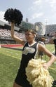 Aug 31, 2013; Cincinnati, OH, USA; Purdue Boilermakers cheerleader cheers during the second quarter during a game against the Cincinnati Bearcats at Nippert Stadium. Mandatory Credit: David Kohl-USA TODAY Sports