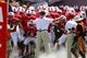 August 31, 2013; Raleigh, NC, USA;  North Carolina State head coach Dave Doeren holds his players back before running to the field for the opening kickoff against Louisiana Tech at Carter Finley Stadium. Mandatory Credit: James Guillory-USA TODAY Sports