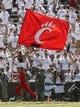 Aug 31, 2013; Cincinnati, OH, USA; Cincinnati Bearcats cheerleader runs past the crowd with a team flag during the fourth quarter at Nippert Stadium. Cincinnati beat the Purdue Boilermakers 42-7. Mandatory Credit: David Kohl-USA TODAY Sports