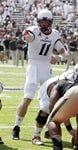 Aug 31, 2013; Cincinnati, OH, USA; Cincinnati Bearcats quarterback Brendon Kay (11) points at the line in the second half during a game against the Purdue Boilermakers at Nippert Stadium. Cincinnati won 42-7. Mandatory Credit: David Kohl-USA TODAY Sports