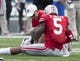 Aug 31, 2013; Columbus, OH, USA; Ohio State Buckeyes quarterback Braxton Miller (5) is treated by a member of the training staff after a play against the Buffalo Bulls at Ohio Stadium. Ohio State won the game 40-20. Mandatory Credit: Greg Bartram-USA TODAY Sports