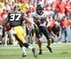 Aug 31, 2013; Iowa City, IA, USA; Northern Illinois Huskies wide receiver Angelo Sebastiano (85) makes a catch against Iowa Hawkeyes defensive back John Lowdermilk (37) during the second quarter at Kinnick Stadium. Mandatory Credit: Mike DiNovo-USA TODAY Sports