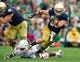 Aug 31, 2013; South Bend, IN, USA; Notre Dame Fighting Irish running back Cam McDaniel (33) runs as Temple Owls safety Jihaad Pretlow (24) defends in the second quarter at Notre Dame Stadium. Notre Dame won 28-6. Mandatory Credit: Matt Cashore-USA TODAY Sports