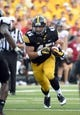 Aug 31, 2013; Iowa City, IA, USA; Iowa Hawkeyes fullback Mark Weisman (45) rushes the ball against the Northern Illinois Huskies during the fourth quarter at Kinnick Stadium. Northern Illinois defeats Iowa 30-27. Mandatory Credit: Mike DiNovo-USA TODAY Sports